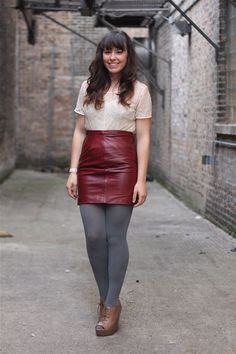 Burgundy leather skirt, lace shirt and charcoal tights.