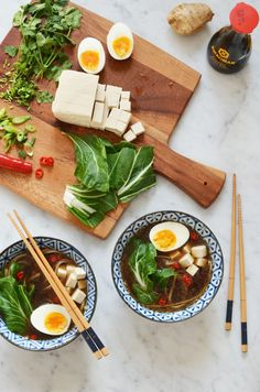 Recipe for spicy homemade ramen broth with all the toppings, including tofu, soft boiled eggs, fresh cilantro, red chili peppers, green onion, bok choy and buckwheat noodles. Gluten free! By That Healthy Kitchen