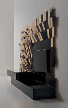 WAVE is TV panel and unusual storage units for books, magazines or DVDs.