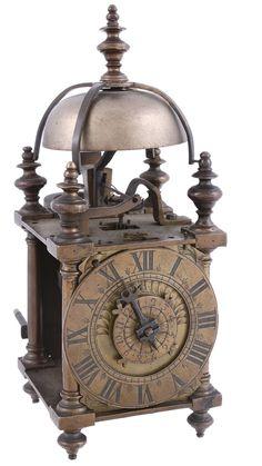 A brass miniature lantern timepiece with alarm Unsigned