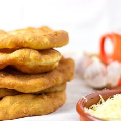 Langos (pronounce Langosh) is a Hungarian deep fried flat bread (made of yeast, flour & water) that is eaten while still warm. Only 5 ingredients!