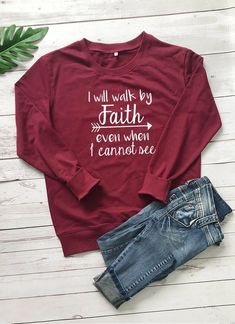 I Will Walk by Faith Sweatshirt | Wear this Sweater with pride knowing that a % of your purchase goes towards spreading the word of God. Part will go to building new churches, and part will go to sending missionaries around the world. Our I Will Walk by Faith Sweatshirt is not only adorable but extremely soft too! Its bold Message will be sure to turn heads! #christianapparel #womensfashion #winteroutfits #winterfashion #sweateroutfits #winteroutfits #sweater #womenssweater #valerymilano Pullover Hoodie, Pullover Sweaters, Crew Neck Sweatshirt, Graphic Sweatshirt, Sweater Hoodie, Graphic Tees, Christian Hoodies, Christian Clothing, Christian Apparel