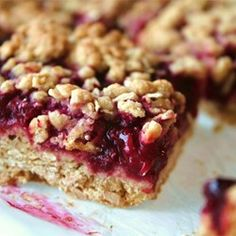 "Delicious Raspberry Oatmeal Cookie Bars | ""Super yummy, followed directions exactly, except I only had apricot jam on hand. I am so excited to make these myself, I have paid $2 a square at my coffee shop for these. Easy to make with my two preschoolers- they tried to eat the crumble before we even baked them."""