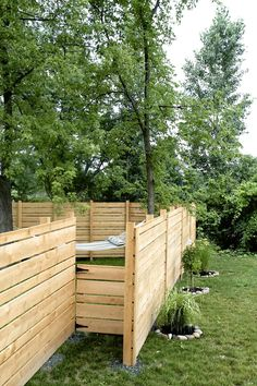 DIY Custom Hemlock fence with hidden gate from www.theuniquenest.com