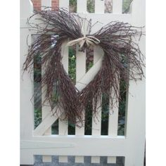Birch Twig Rustic Heart Wreath - Make your own decoration to hang on your garden gate by shaping wire into a heart and use fishing line or fine gauge wire to twist & tie twigs in place around it. Finish with a rafia bow.   The Micro Gardener