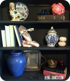 """Have beloved keepsakes you are storing in closets and boxes?  Gather up those sentimental treasures and use them for a decorative vignette without it looking """"junky"""".  Great use of on-hand items that are loved.  DIY decorating at it's finest."""