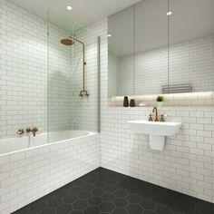 #Pivotech Duo #BathPanel in this cute #black #white #bathroom with #subway wall #tiles and #hexagon floor #tiles. #bathroom #design #retrobathroom #shower #bath http://www.pivotech.com.au/shower-screens/bath-panels/