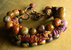 Agua nueva agate, artistic stone, fibers and Indonesian glass beads blended in the colors of the southwest. This new bracelet is part of my Maricopa