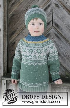 Seiland Jumper / DROPS Children - Set consists of: Sweater for kids with round yoke and multi-colored Nordic pattern, worked top down. Hat with multi-colored Nordic pattern and pompom. Size 2 - 12 years Set is knitted in DROPS Merino Extra Fine.
