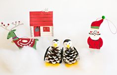 Pine Cone Penguin Kids Ornament Craft   Who would have thought that crafts with pine cones could look so darn cute on the Christmas tree?