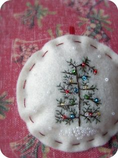 tiny tree embroidery with seed pearl ornaments. maybe try this with ribbon embroidery for ornaments. Felt Christmas Ornaments, Christmas Fun, Christmas Decorations, Beaded Ornaments, Crochet Christmas, Embroidered Christmas Ornaments, Ornaments Ideas, Beautiful Christmas, Tree Decorations