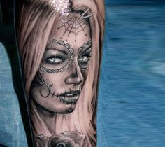 Realistic black and gray tattoo of Muerte by artist Proki Tattoo