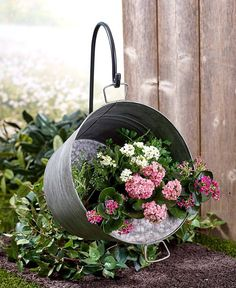 """Perk up your yard with colorful flowers growing in this Hanging Pail Planter with Shepherd's Hook. The bottom of the pail has holes to let the water drain out. Planter, 15-3/4"""" dia. Shepherd's hook, 11-3/4""""W x 32-1/4""""H, including the 6"""" ground stake. 