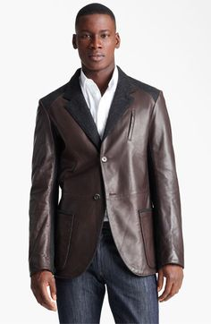 Salvatore Ferragamo Cotton Trim Leather Jacket. Striking fabric panels define a dashing two-button blazer cut from rich, glossy nappa lambskin and detailed with a notch lapel and a pair of oversized patch pockets.