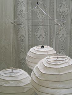 Hang lantern clusters with wire - or wire clothes hanger curved into a circle! (inspiration only)