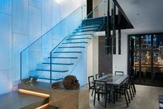 The stair is positioned infront of a illuminated concrete wall. Although the stairs was aimed to be as invisble as possible it is still an eye-catcher for itself. Glass Stairs, House Stairs, Corian, Concrete Wall, Staircase Design, Minimalist, Wood Steel, Modern, Catcher