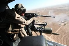 U.S. Marine Corps Cpl. Jeffery L. Allen, crew chief with Marine Light Attack Helicopter Squadron (HMLA) 469, Marine Aircraft Group 39, 3rd Marine Aircraft Wing (Forward), provides close air support over Helmand province, Afghanistan, Nov. 8, 2012. Allen provided close air support to members with International Security Assistance Force.  (U.S. Marine Corps photo by Sgt. Keonaona C. Paulo/Released)