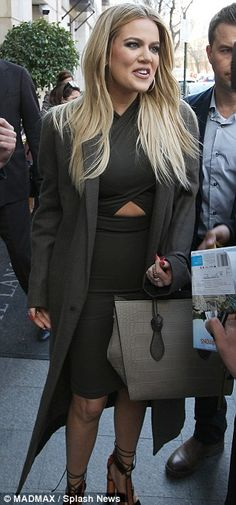 Cut it out! Khloe Kardashian showed off her trim tummy as she stepped out in a cut-out oli...