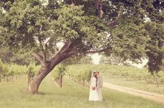 So romantic...I adore big open fields and beautiful trees.  This is the perfect setting for a wedding :)