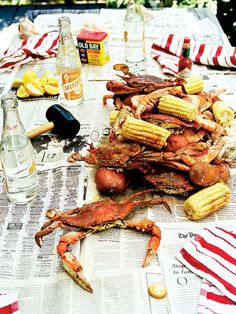 How to host a Maryland crab boil! Learn how to throw the best summer dinner party! From recipes to decor, shop the products from the story curated by our entertaining experts. For more table setting ideas and dinner party themes go to Domino. Shrimp And Crab Boil, Seafood Boil, Fish And Seafood, Seafood Recipes, Seafood Dishes, Fresh Seafood, Seafood Shop, Crawfish Recipes, Cajun Dishes