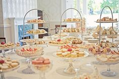 tea party food in clear dishes and on white and metal tiers