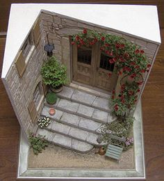 MINIATURAS DE ROSYCould be an entry en Provence if door and shutters were blue and flowers more colorful (RM)
