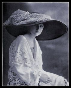 Circa 1912. She's wearing some kind of amazing Irish crochet lace mantle. Wow!