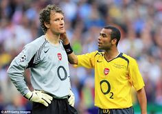 Former Gunners left back Ashley Cole attempts to console Jens Lehmann at full-time