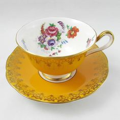 Made by Royal Albert, tea cup and saucer are yellow with flowers. Gold trimming on cup and saucer edges. Great condition with no chips or cracks, please note there is some wear to the gold on the handle of the tea cup (see photos). Markings read: Royal Albert Bone China England