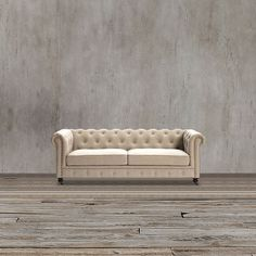 Add an elegant comfort for your living room or family room with this beige cehsterfield sofa. Features solid hardwood frame, beige linen uphostery, Hand-tufted rear cushion, arms and front, hand-applied iron nailheads with brass finish and light walnut finish wood legs.
