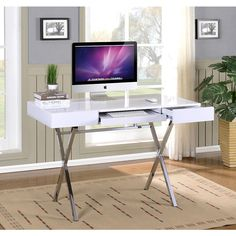 The computer desk in an X design creates a modern looking unit that is ready to help you tackle your daily tasks. Features computer desk in a white glossy finish with a  pullout keyboard tray.