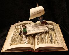 "Tom Sawyer Book Sculpture. $ 85.00, via Etsy. Tom Sawyer Book Sculpture by Jodi Harvey-Brown Tom Sawyer and Huckelberry Finn set sail in this book sculpture. The sculpture is made from a 1946 publication of ""The Adventures of Tom Sawyer"". Tom and Huck sit on a raft constructed of the books pages as they float down the Mississippi. Both figures are illustrations from the book that have been hand colored."