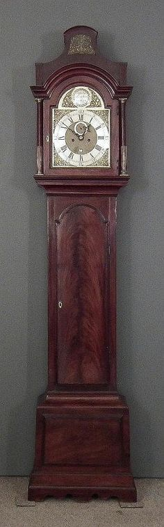 An 18th Century mahogany longcase clock by Phillip Stephens of London, the 12ins arched brass dial with wide silvered chapter ring with Roman and Arabic numerals, subsidiary seconds dial and date aperature to the eight day two train, five pillar movement striking on a bell, contained in figured mahogany case with pagoda top above moulded cornice, and with turned fluted and brass topped columns to hood, arched trunk door and plinth with raised mouldings and double plinth base, 95ins high