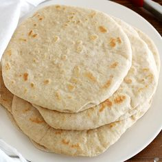Homemade soft flatbread made on the griddle -- perfect for warm pita sandwiches with Mediterranean fillings!