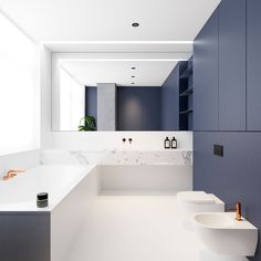 Beautiful, minimal bathroom with white marble and blue cabinetry. FontanB in Kiev, Ukraine. Designed by Emil Dervish.