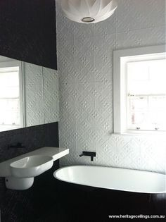 A stunning feature was required for the walls in this bathroom. The Bluebells pressed tin design was used. Three walls painted white and one painted black. Bathroom Feature Wall, Art Deco Bathroom, Bathroom Wall, Feature Walls, Beach House Bathroom, Laundry In Bathroom, Bathroom Renos, Bathroom Renovations, Pressed Tin