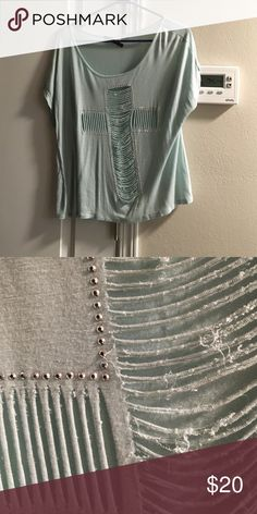 Mint Cross Top Very flowy. Worn once but didn't wear again. I don't like showing my stomach but didn't want to wear a Cami so I'm just going to seek instead. No stains, no holes other than the ones made on the shirt. Tops Blouses