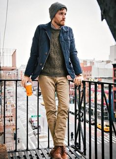 Shop this look on Lookastic:  http://lookastic.com/men/looks/beanie-longsleeve-shirt-cable-sweater-barn-jacket-chinos-boots/5996  — Charcoal Beanie  — Charcoal Long Sleeve Shirt  — Dark Brown Cable Sweater  — Navy Barn Jacket  — Khaki Chinos  — Brown Leather Boots