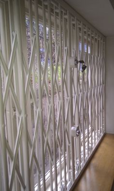 RSG1000 retractable security grilles fitted in a window on a ground floor flat in London