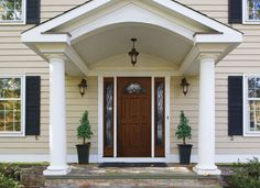 Decorative glass adds style and curb appeal in this fan light entry door with side transoms from Pella Windows and Doors.