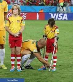 Mark Bresciano, tying his mascot's shoe.....best World Cup 2014 photo.