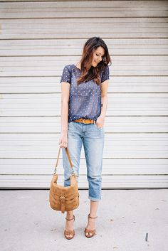 Blue printed sheer top, white camisole, boyfriend jeans, ankle strap heels, saddle bag.