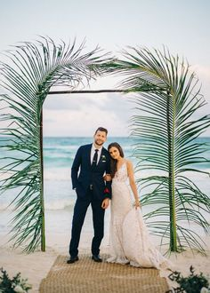 Palm leaves wedding arch: http://www.stylemepretty.com/little-black-book-blog/2016/10/07/elegant-tulum-wedding/ Photography: Sean Cook - http://seancookweddings.com/