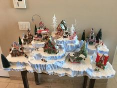 North Pole Village Display for 8 to 10 Buildings Diy Christmas Village Platform, Diy Christmas Village Displays, Department 56 Christmas Village, Halloween Village Display, Christmas Tree Village, Christmas Town, Christmas Tree Themes, Christmas Villages, Christmas Diy