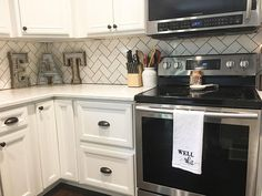 Black Counter White Cabinets, Black Counters, Kitchen Reno, Kitchen Remodel, Farmhouse Decor, Modern Farmhouse, Farmhouse Style, Herringbone Subway Tile, Split Level Kitchen