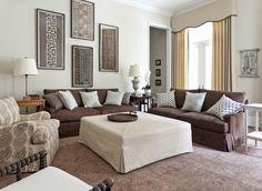 Brown sofas against light neutral background