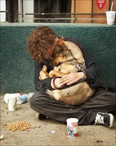 Homeless man with a dog