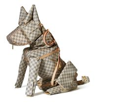 Artist Billie Achilleos transforms Louis Vuitton Small Leather Goods into fantastic creatures of all sizes.  Man's best friend has never been so stylish!