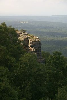 MOUNT MAGAZINE.....tallest mountain in Arkansas....2,753 ft elevation....vistas of broad river valleys, deep canyons, and distant mountains....a flat-topped plateau with a sandstone cap rimmed by rock cliffs....its name came from French explorers traveling through the area that heard a landslide and said the noise sounded like an ammunition magazine exploding