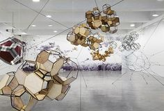 """Argentinian Artist Tomás Saraceno created """"Cloud City"""", a stunning installation at NYC's Metropolitan Museum of Art.  The sculpture is a constellation of large, interconnected modules constructed with transparent and reflective materials for the Museum's Iris and B. Gerald Cantor Roof Garden."""
